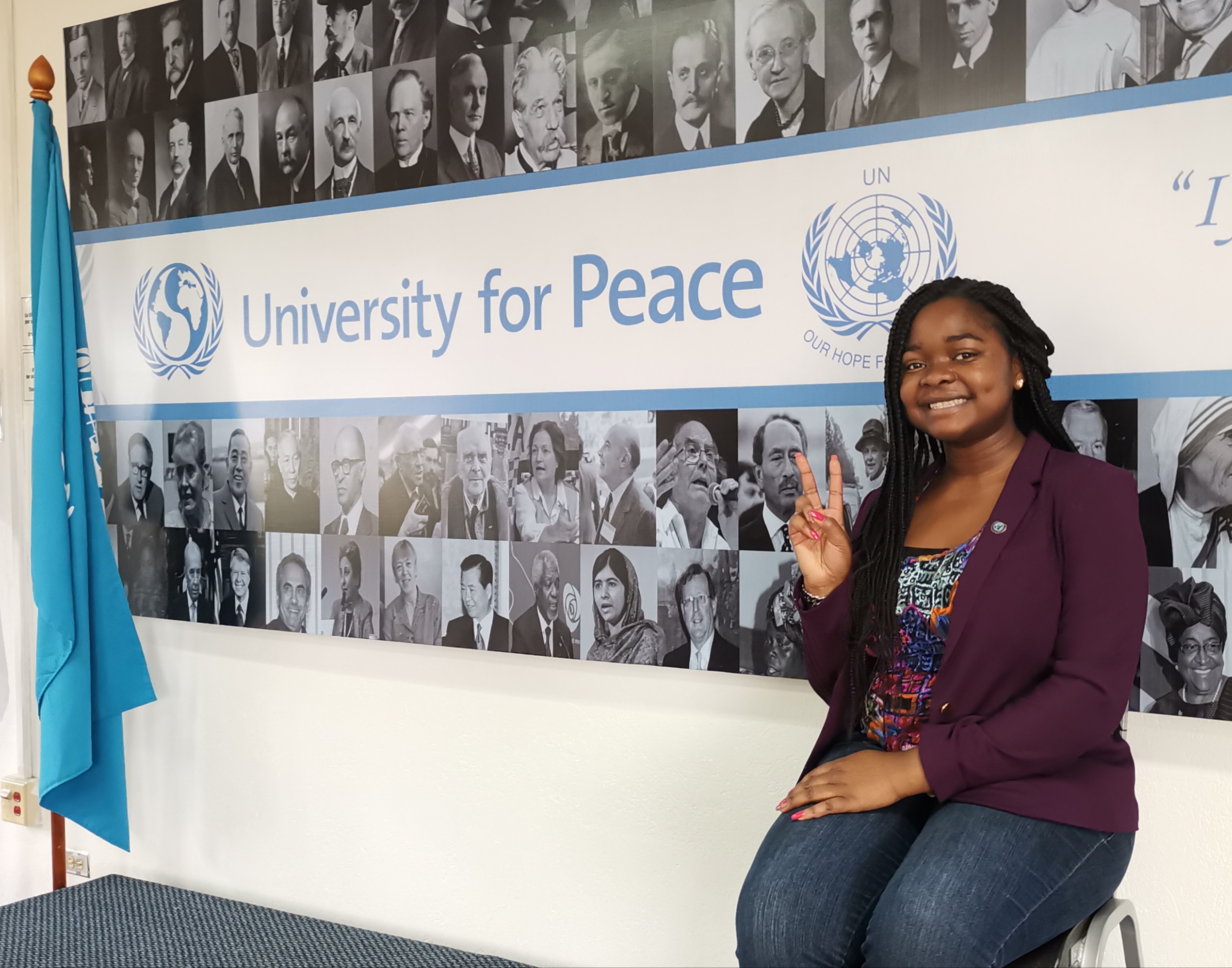 girl saying hi at the University for Peace